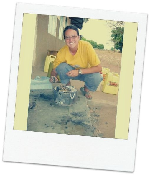 Sarah, owner of fair trade jewelry company International Blessings, cooking in Uganda.