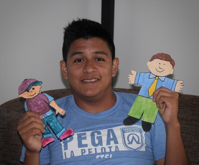 Daniel posing with Flat Stanley and Flat Will